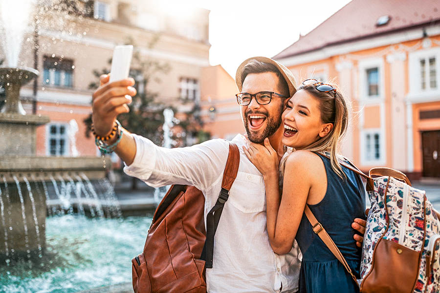 Happy tourist couple in love dating, laughing on vacation